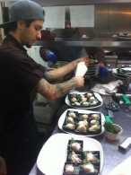 Chef Alex Montoya adds the finish touch to seared salmon: lemon goat cheese